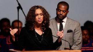 FILE - In this Wednesday, Oct. 23, 2019 file photo, Maryland State Attorney Marilyn Mosby, left, speaks while standing next to her husband, Maryland Assemblyman Nick Mosby, during a viewing service for the late U.S. Rep. Elijah Cummings at Morgan State University in Baltimore. Federal prosecutors have launched a criminal investigation into the finances of Baltimore's top prosecutor and her husband, who is city council president. The Baltimore Sun reported Friday, March 19, 2021 that it obtained a grand jury subpoena seeking business records for State's Attorney Marilyn Mosby and City Council President Nick Mosby, including tax returns, bank and credit card statements and other documents.