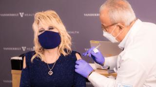 Dolly Parton receives her coronavirus vaccine in Nashville, Tennessee.