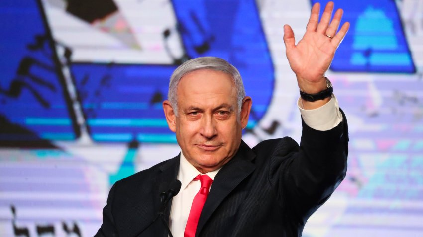 In this March 24, 2021, file photo, Israeli Prime Minister Benjamin Netanyahu waves to his supporters after the first exit poll results for the Israeli parliamentary elections at his Likud party's headquarters in Jerusalem.