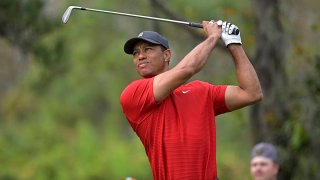 FILE - Tiger Woods watches his tee shot on the fourth hole during the final round of the PNC Championship golf tournament in Orlando, Fla., on Dec. 20, 2020.