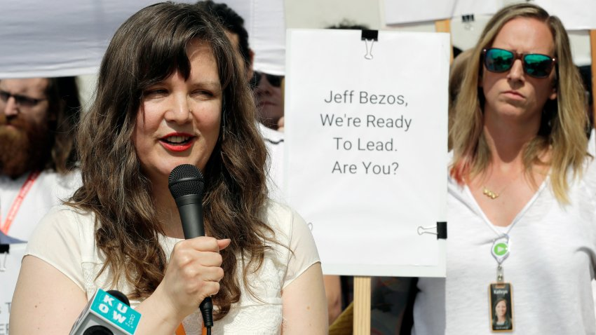 FILE - Emily Cunningham, left, speaks as Kathryn Dellinger, right, looks on during a news conference following Amazon's annual shareholders meeting, Wednesday, May 22, 2019, in Seattle. The National Labor Relations Board has found that two outspoken Amazon workers were illegally fired last year. Both employees, Emily Cunningham and Maren Costa, worked at Amazon offices in Seattle and publicly criticized the company, pushing it to do more to reduce its impact on climate change and to better protect warehouse workers from the coronavirus. The NLRB confirmed Monday, April 5, 2021 that it found merit in the case.