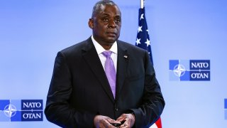 FILE - In this April 14, 2021, file photo, Secretary of Defense Lloyd Austin poses for photographers as he arrives at NATO headquarters in Brussels. The Associated Press has learned that a Pentagon panel is recommending that decisions to prosecute service members for sexual assault be made by independent authorities, not commanders. It would be a major reversal of military practice and a change long sought by Congress members.