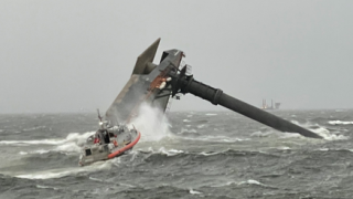 In this April 13, 2021, file photo, a commercial lift boat is seen capsized off the coast of Louisiana.