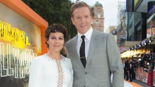 """Actors Helen McCrory, left, and Damian Lewis appear at the premiere of """"Once Upon A Time in Hollywood,"""" in London on July 30, 2019. McCrory, who starred in the television show """"Peaky Blinders"""" and the """"Harry Potter"""" movies, has died. She was 52 and had been suffering from cancer. Her husband, actor Damian Lewis, said Friday that McCrory died """"peacefully at home"""" after a """"heroic battle with cancer."""""""