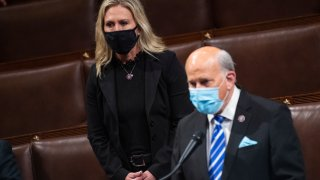 Reps. Louie Gohmert, R-Texas, and Marjorie Taylor Greene, R-Ga., rise in objection to a states Electoral College votes be certified during a joint session of Congress in the House chamber on Thursday, January 7, 2021.