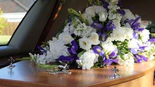 A coffin inside a hearse