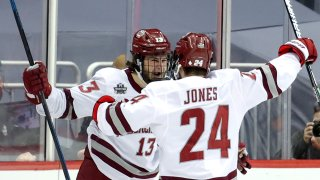 UMass Minutemen players celebrate a goal during the NCAA Division I Men's Ice Hockey Championship game