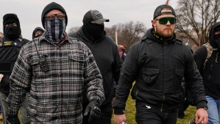 FILE - In this Jan. 6, 2021, file photo, Proud Boys members Joseph Biggs, left, and Ethan Nordean, right, walk toward the U.S. Capitol in Washington.
