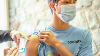 A young man receives his Covid-19 vaccination