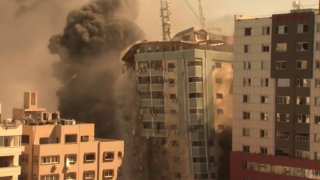 A building housing various international media, including The Associated Press, collapses after an Israeli airstrike