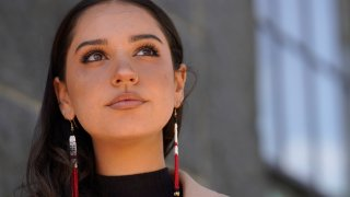 """Samantha Maltais, an incoming Harvard Law student, seen May 25, 2021, in New Bedford. When Maltais steps onto Harvard's campus this fall, she'll become the first member of the Aquinnah Wampanoag tribe to attend its prestigious law school. """"Coming from a tribal community in its backyard, I'm hyper aware of Harvard's impact,"""" said Maltais, the 24-year-old daughter of her tribe's chairwoman."""