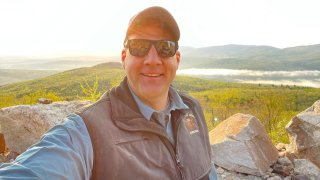 New Hampshire Gov. Chris Sununu takes a selfie as he began a daylong road trip with his cousin across the Granite State.