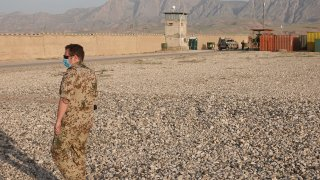 A soldier stands in front of an outer wall of the camp with a watchtower during a visit by Foreign Minister Maas (SPD, not in picture) to Camp Marmal in the northern Afghan city of Mazar-i-Sharif. Maas is visiting Afghanistan ahead of the Nato troop withdrawal to assess the situation on the ground. He has promised the country further support for the time after the withdrawal.