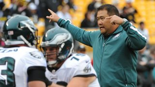 PITTSBURGH, PA - OCTOBER 7: Offensive line assistant Eugene Chung of the Philadelphia Eagles directs players during pregame warmup prior to a game against the Pittsburgh Steelers at Heinz Field on October 7, 2012 in Pittsburgh, Pennsylvania. The Steelers defeated the Eagles 16-14.