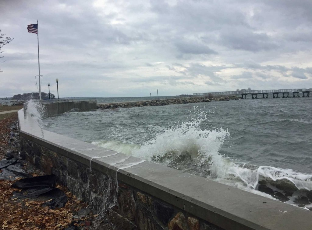 Water flooding over the seawall on the coast of Connecticut