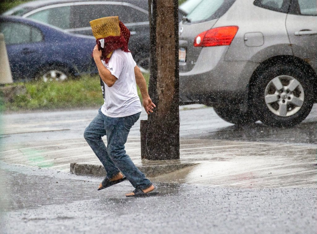 A person runs for shelter from the rain