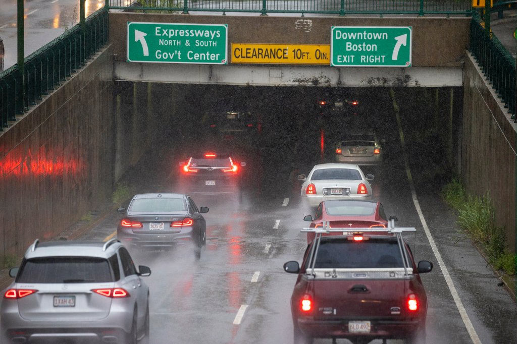 Cars drive into a tunnel on Storrow Drive
