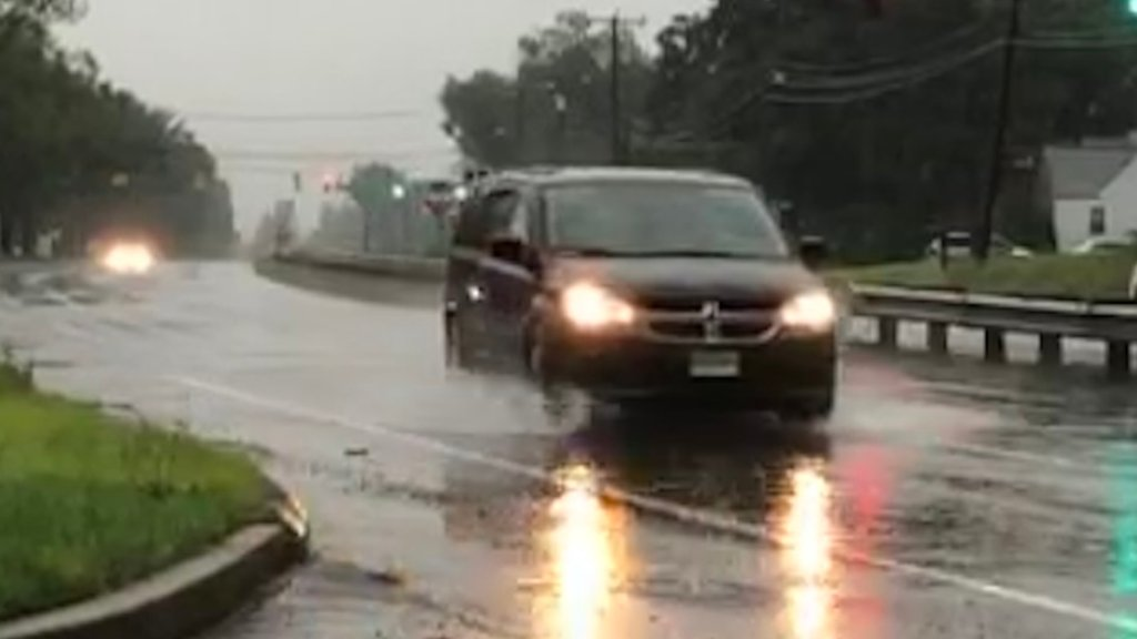 Car driving in East Hartford during Tropical storm Elsa
