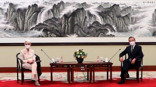 In this photo provided by the U.S. Department of State, U.S. Deputy Secretary of State Wendy Sherman, left, and Chinese Foreign Minister Wang Yi sit together in Tianjin, China, July 26, 2021.