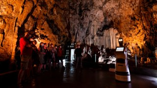 Persephone guides the visitors inside Alistrati cave