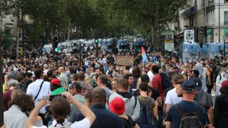People demonstrate against new health laws likely to come into force from Aug. 9, in Paris on July 31, 2021.