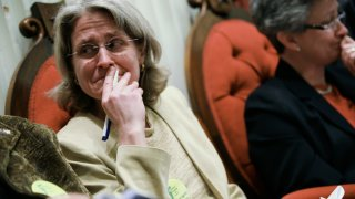 This April 7, 2009, file photo shows Beth Robinson, then on the Vermont Freedom to Marry Task Force, react as votes get close enough for a veto override for the same sex civil marriage law at Vermont's State House in Montpelier.
