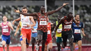 Kenya's Emmanuel Kipkurui Korir (C) reacts after winning next to second placed Kenya's Ferguson Cheruiyot Rotich after the men's 800m final during the Tokyo 2020 Olympic Games