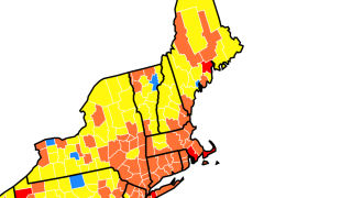 A map showing community transmission rates of COVID-19 in New England