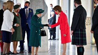 Britain's Queen Elizabeth II is greeted by Scotland's First Minister Nicola Sturgeon