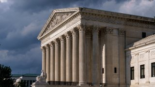 FILE - This June 8, 2021 file photo shows the Supreme Court building in Washington. The future of abortion rights is in the hands of a conservative Supreme Court that is beginning a new term Monday, Oct. 4, that also includes major cases on gun rights and religion.