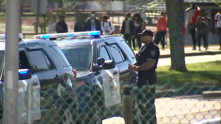 A Brockton police officer outside Brockton High School, where a student brought a gun to school on Friday, Oct. 8, 2021.