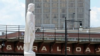 This June 23, 2020, file photo shows the Christopher Columbus statue at Worcester's Union Station after it was hit with red paint.