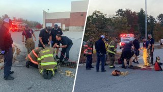 Firefighters rescuing a person trapped in a Concord, New Hampshire, storm drain