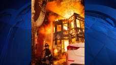 Neighbor, Officer Rescue Woman From Burning Apartment