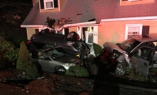 Wild Scene as Pickup Crashes Into 2 Vehicles, House