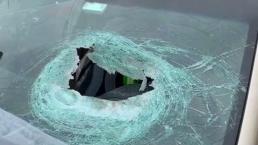 Driver Injured After Wooden Block Breaks Windshield