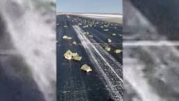 Gold Spills From Plane on Russian Runway