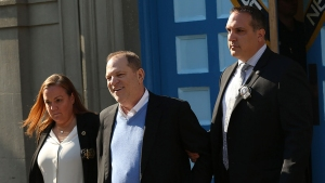 Smiling, Cuffed Weinstein Charged With Felony Rape in NYC