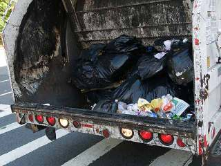 Man Scooped up by Calif. Garbage Truck Survives Ride