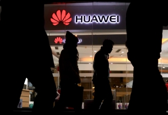 China Summons US Envoy to Protest Detention of Huawei Exec