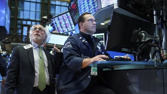 Dow Erases 2018 Gains as It Drops Over 450 Points