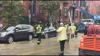 2 People Evaluated After Water Floods Street in Boston