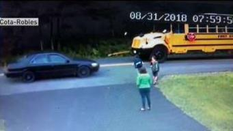 CLOSE CALL: Child Almost Hit by Car Getting on School Bus