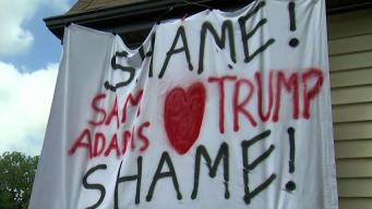 'I Was Outraged': Man Hangs Protest Sign Near Sam Adams