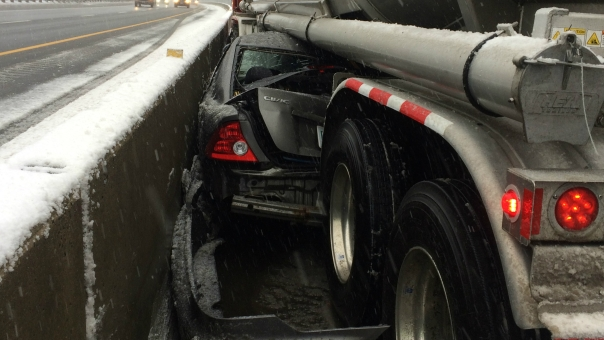 Car Pinned Under Tanker Truck, Driver Miraculously Survives