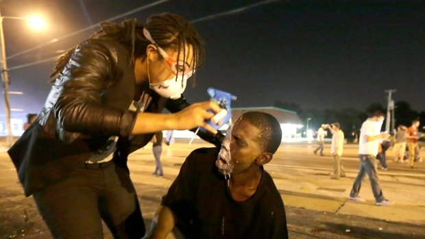 [NATL] Police, Protesters Clash in Ferguson