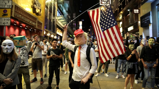 [NATL] Hong Kong Protesters Test Mask Ban in Full Halloween Regalia