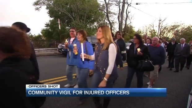[NECN] Community Vigil for Boston Officers Wounded in Shooting