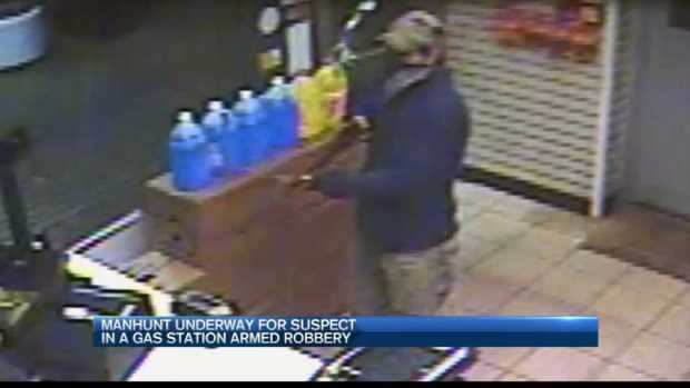 [NECN] Manhunt Continues for Gas Station Robber
