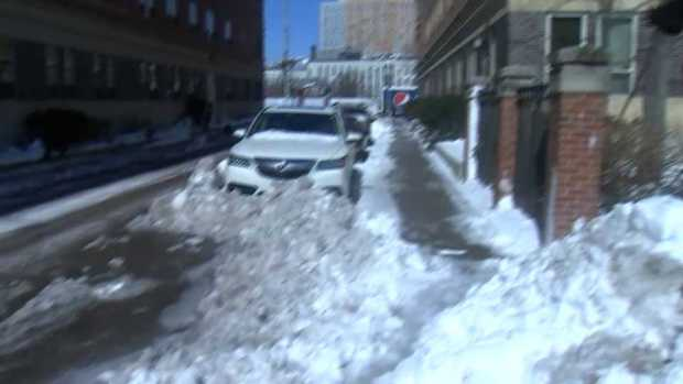 Boston Continues to Clear Streets of Snow, Ice